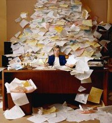 desktop_clutter_cluttered_desk_paper_stack_mess